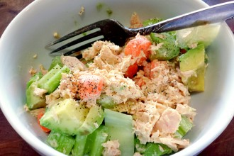 Tuna Salad with paleo mayo, baby carrots, and celery, in a white bowl.